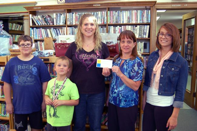 LINDA KOEHLER/TIMES NEWS Patti Garey of Palmerton, third from left, won the Palmerton Area Library's Gold Card. Her name was picked out of the pool of new patrons to the library. For one year, members of her family will receive no late fines and be…