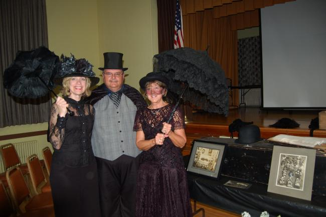 "LINDA KOEHLER/TIMES NEWS Concourse Club of Palmerton members, left, Christine Campbell and Barbara Hafer-Prout, right, came dressed for a Victorian funeral at the October meeting. ""Undertaker"" Dale Freudenberger, president of the Tamaqua Historical…"