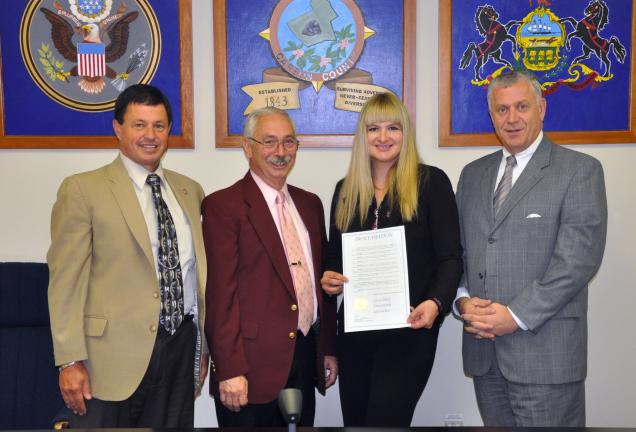 AMY MILLER/TIMES NEWS Devon Fritz, Carbon County counselor of the Domestic Violence Service Center, second from right; accepts the proclamation naming October as Domestic Violence Awareness Month in Carbon County. With her are, from left, Carbon…