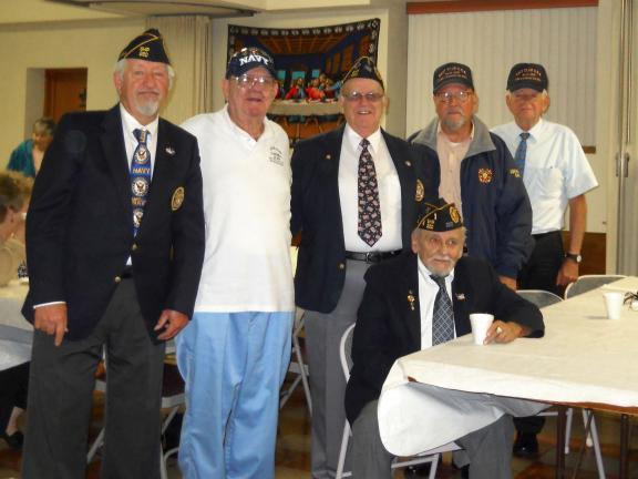 SPECIAL TO THE TIMES NEWS Navy Club of Carbon County members enjoy refreshments after the services honoring the Navy Birthday. Seated is Robert Siesputowski, junior executive officer. Standing, from left, are Scott T. Reinhart, commander; James F…