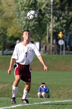 MARY ELLEN KMETZ/Special to TIMES NEWS Lehighton's Dan Baka uses a header to pass the ball to a teammate during District 11 2A boys soccer action against Jim Thorpe.