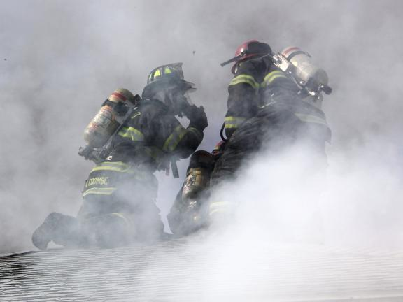 ANDREW LEIBENGUTH/TIMES NEWS Firefighters work to squelch a fast-moving fire in Coaldale Thursday afternoon.