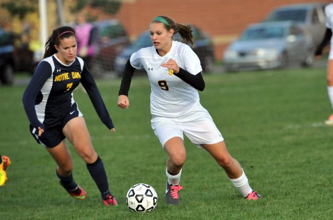 Nancy Scholz/special to the times news Northwestern's Sarah Segan (right) dribbles past Notre Dame's Emma Krentler.