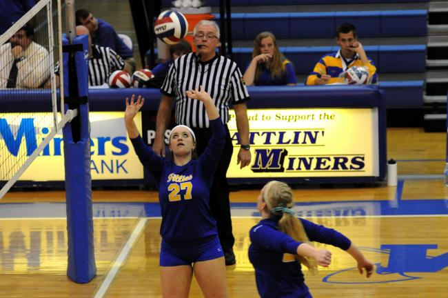 ron gower/times news Marian's Abby O'Donnell sets the ball during her team's District 11 Class A semifinal match with Salem Christian.