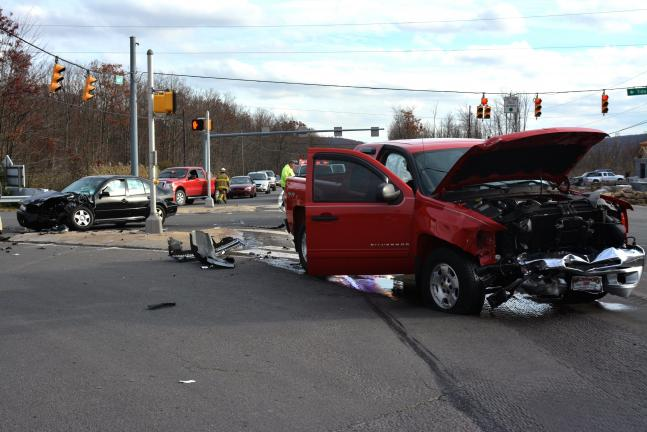 DONALD R. SERFASS/TIMES NEWS A grinding head-on collision Tuesday afternoon in Hometown sent one driver to the hospital. The other refused treatment at the scene.