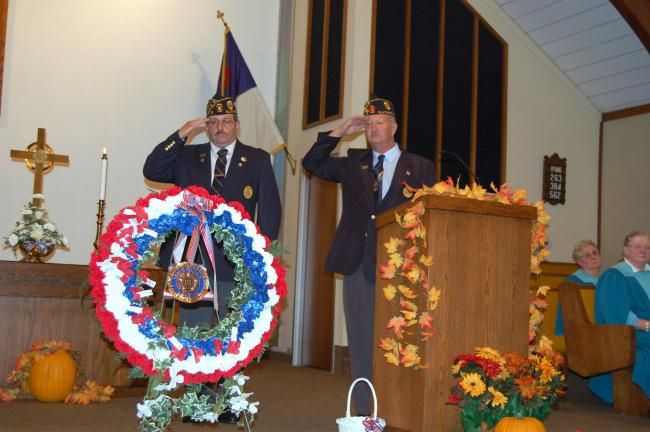 "ELSA KERSCHNER/TIMES NEWS Commander George Burke and Veterans Day chair Dennis Ziegler salute as ""Taps"" is played."