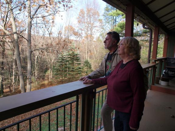 "AL ZAGOFSKY/SPECIAL TO THE TIMES NEWS From the rear porch of their Hill Home Forge Bed & Breakfast in Jim Thorpe, Nic and Eileen East look out onto their yard which has been called by an eBird contributor as a ""really good bird center."""