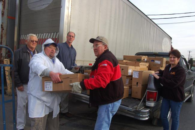 TERRY AHNER/TIMES NEWS  Country Harvest Family Market in Palmerton will donate turkeys to serve 210 families in the Palmerton Area School District this Thanksgiving holiday. Pictured are clockwise Ron Anthony, CACPAC volunteer, Gary Bonser, meat…