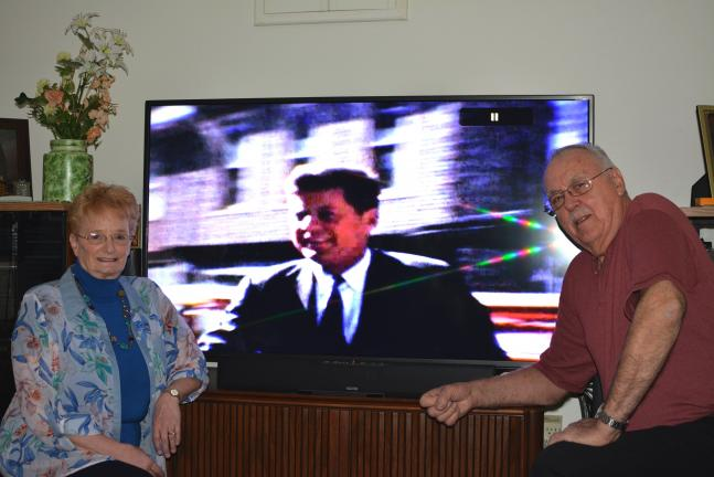 DONALD R. SERFASS/TIMES NEWS Marlin and Carolyn Tirpak reflect on the color footage Saturday of John F. Kennedy's 1960 visit to Tamaqua. Marlin filmed the future president, greeted him and shook his hand.