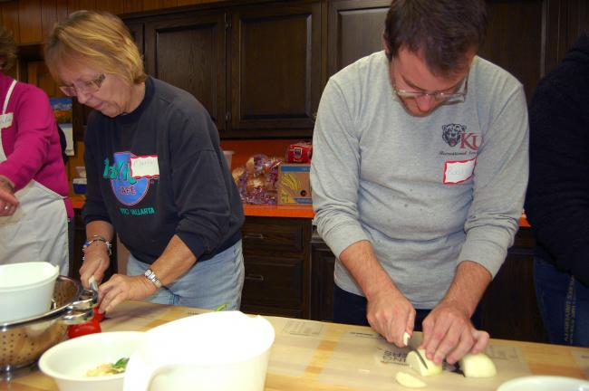 "Gail Maholick/times news Marla Haydt and her son, Rusty Haydt, prepare ""The Works Pizza"" during the first ""Share Our Strength's Cooking Matters for Adults,"" program held at Zion United Church of Christ, sponsored by Second Harvest Food Bank."