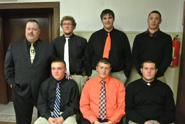 @Caption Stand Alone:Panther Valley football seniors Senior members of the Panther Valley football team were honored during a recent banquet. The seniors were, front row, from left, Kyle Ferryman, Zach Stromelo and Mark Williams. Back row, coach Lon…