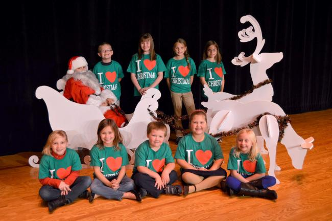 "KAREN CIMMS/TIMES NEWS Some of the cast members for ""I Love Christmas"" include, seated, from left, Lillian Heydt, Erin Remmel, Cole Harwood, Brinn Harwood and Willa Bartholomew. Second row, Jordan Remmel (Santa), Brayden Harleman, Brooke McElmoyle,…"
