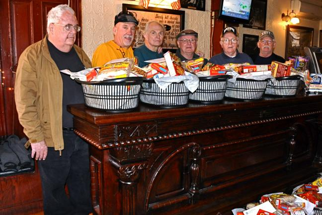 "Members of Jim Thorpe's AOH ""Alec Campbell, Mauch Chunk Division #1"" who helped prepare Thanksgiving Day food baskets last Saturday at Molly Maguires Pub & Steakhouse in JT are, left to right : John Barry, Chip Burnett, Matt Stinson, Hugh…"