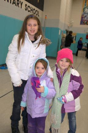 Gail Maholick/TIMES NEWS Sheridan Wall, a fifth grade student at Panther Valley Elementary School, was happy to find a coat. She shopped with Bella Wall, 3; and Nakiah Wall, 5, who also found new coats.