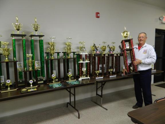 JUDY DOLGOS-KRAMER/SPECIAL TO THE TIMES NEWS Lake Harmony Fire Chief, Ralph Lennon shows off some of the 32 trophies that Station 17 brought home in 2013.