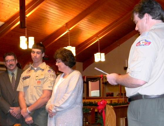 LISA PRICE/TIMES NEWS Connor Veglia, center, during his Eagle Scout Court of Honor ceremony. With his are his father, Brian Veglia, far left, and his mother, Judy Veglia. At far right, is Eric Resch, assistant district commissioner of Black Rock…