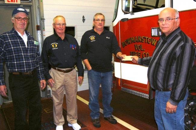 "ELSA KERSCHNER/TIMES NEWS The Bowmanstown-Parryville Lions Club presented a check to Michael Spairana, right, fire chief of the Bowmanstown Fire Company. The presentation was made by Norman ""Junior"" Engle, a Lion and president of the fire company as…"
