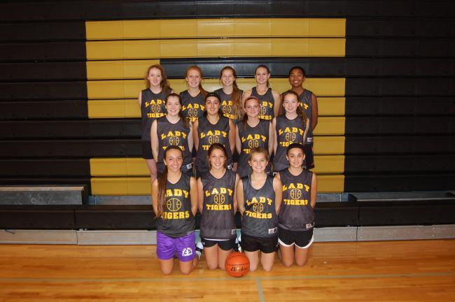 MIKE HAINES/TIMES NEWS Members of the Northwestern girls basketball team for the 2013-14 season include, front row from left, Sabrina Mertz, McKenzi Divers, Kylee Bennett, Erynn Day; middle row, Erika Thomas, Mikaela Koenig, Haley Hebelka, Taylor…