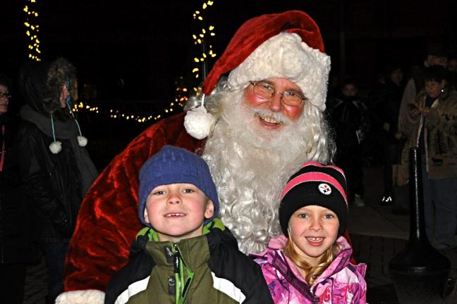 VICTOR IZZO/Special to the TIMES NEWS Seven-year-old Braam Hattingh and his 5-year-old sister Mia of Mechanicsburg got to meet Santa at the Olde Time Christmas Celebration in Historic Jim Thorpe this past weekend.