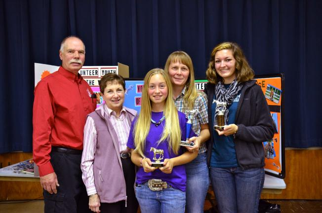 "Harvey Smith, Horses & Horizons' executive director, far left; and program director Elaine Smith, with Youth Volunteer of the Year, Meghan Sfarra; Volunteer of the Year, Denise Schafer; and ""Volunteen"" of the Year, Amanda Carnes."