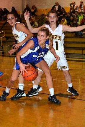 Mike Feifel/TIMES NEWS Palmerton's Jade Farquhar is double teamed by Northwestern's Erynn Day and Kylee Bennett.