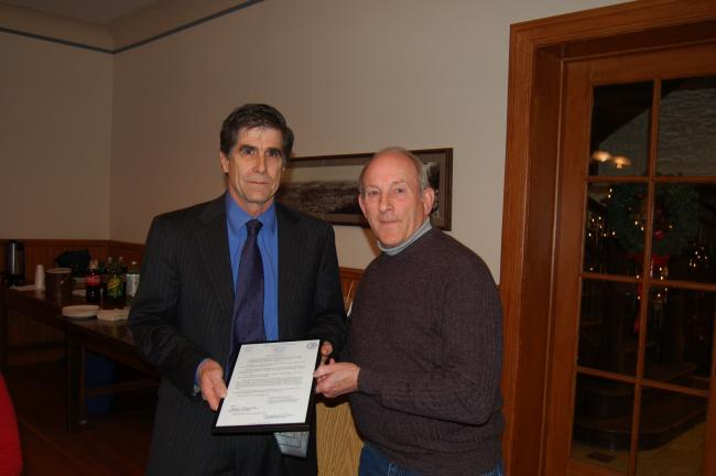TERRY AHNER/TIMES NEWS Palmerton Borough Council President Terry Costenbader (right) presents a resolution to Brad Beers, of Bradco, on Thursday.