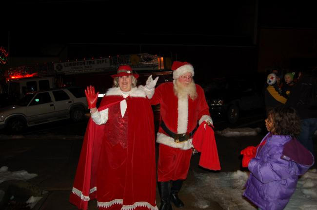 "Santa Claus and Mrs. Claus arrive for ""Christmas in the Park"" in Lehighton."