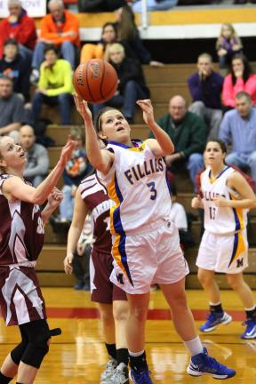 Special to THE TIMES NEWS  Marian's Gabby Green (3) drives the lane to put up a shot during a game last season.