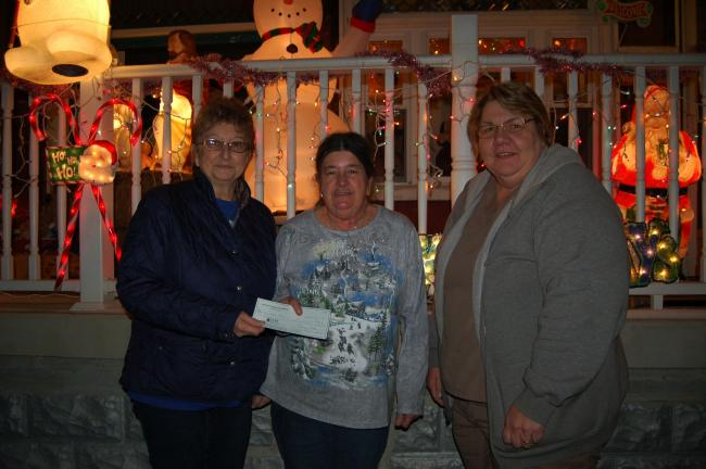 Gail Maholick/TIMES NEWS Linda Schoenberger, left, president of the Weissport Recreation Committee and Tammy Solt, right, treasurer, of the Weissport Recreation Committee; present a check of $100 to Lynette Moyer, center, for winning the 2013…
