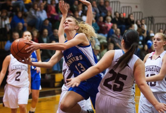 bob ford/times news Palmerton's Jade Farquhar (13) goes up for a shot as Lehighton's Tiff Thompson (25) defends.