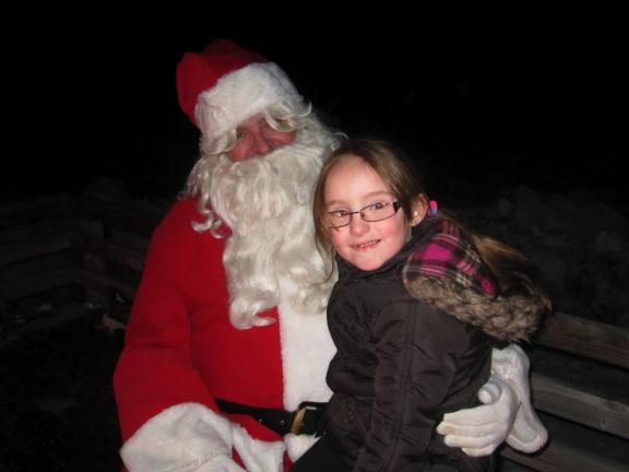 HEATHER BASICK/SPECIAL TO THE TIMES NEWS Luryssa Stelling, age 5, talks with Santa Claus at Sam Miller Field in Jim Thorpe.