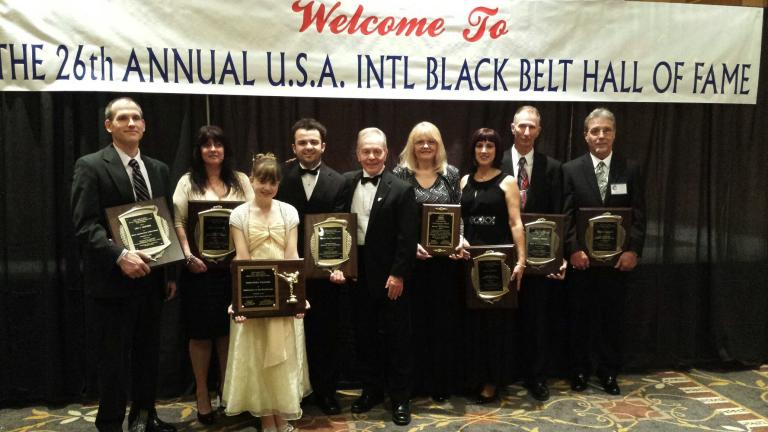 Mountain Karate Academy Award winners were: From left, Master Lee Lesisko, Instructor Kim Fitzpatrick, Cassie Williams, Master Paul Maglionico, Grandmaster John Kanzler, Sharyl Maglionico, Master Jan Kresge, Master Kevin Kresge and Master Steve Meining.