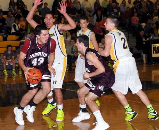 ron gower/times news Lehighton's Vince Mele (43) tries to dribble away from Panther Valley defenders Charles Nase and Chad Dubosky (2) as teammate Jordan Knappenberger moves in to help out.