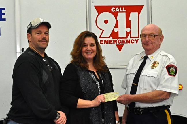 VICTOR IZZO/SPECIAL TO THE TIMES NEWS Justin A. Berger's mother, Cheryl Berger, presents a check in the amount of $6,000 to Albrightsville Volunteer Fire Company President Richard Smallenburg. The money represents the proceeds from the third annual…