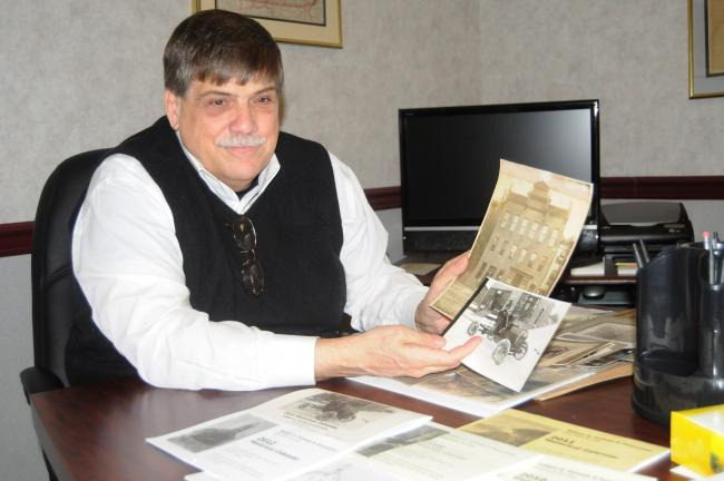 RON GOWER/TIMES NEWS Attorney William Schwab of Lehighton displays some of his post cards and historical memorabilia.