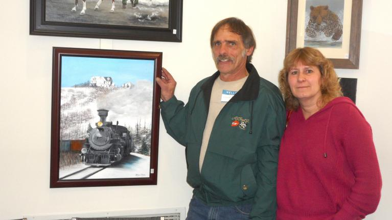 "MARY TOBIA/SPECIAL TO THE TIMES NEWS The acrylic painting ""Rails of Palmerton"" by Douglas Wilkins, left, of Stroudsburg was voted Best of Show at the eighth annual Palmerton Area Library Art Show and Lunch held at the library, sponsored by The…"