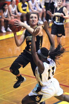 Nancy Scholz/Special to the TIMES NEWS Northwestern's Sabrina Mertz drives to the basket past Tyra Watson of Notre Dame.
