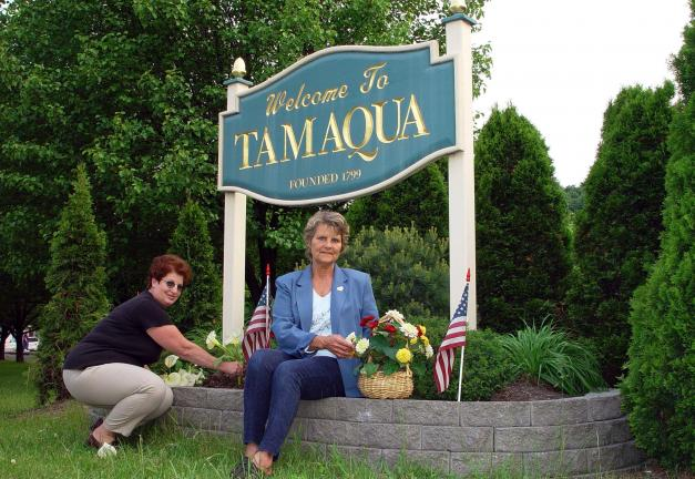 DONALD R. SERFASS/TIMES NEWS The Tamaqua Beautification Association has disbanded after a 25-year run devoted to improving the appearance of the community. Shown are volunteers Linda Heigele and Kay Ann Rottet during a work session several years ago.