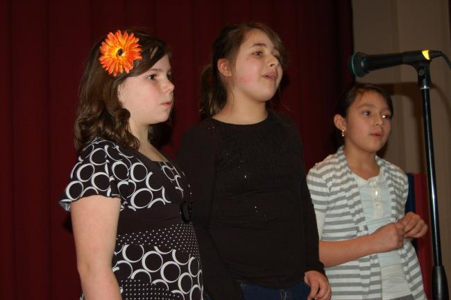 Gail Maholick/TIMES NEWS Lydia Gowin, Antigone Gonzalez and Sophia Sarnowski perform a cappella during the annual talent show for students at Ss. Peter and Paul School.