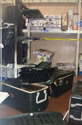 DONALD R. SERFASS/TIMES NEWS These coolers are just part of the merchandise destroyed in an early morning arson fire at the Hometown Walmart on Tuesday. Damage to the store is estimated at $25,000.
