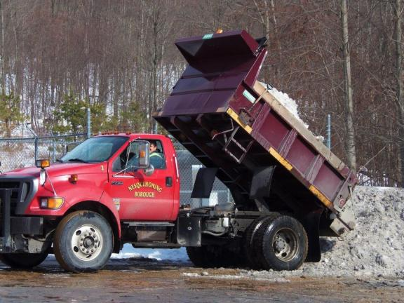 CAROL ZICKLER/SPECIAL TO THE TIMES NEWS Nesquehoning removes snow Matt Miller, Nesquehoning borough street employee, dumps snow that  he removed from Catawissa Street. The borough and three other private  dump trucks helped to removed the snow along…