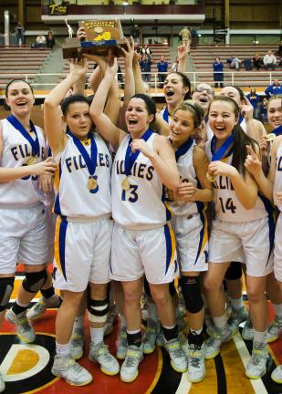 Steve Shinko/special to the TIMES NEWS Marian players hoist the trophy after winning the District 11 Class A girls championship on Saturday.