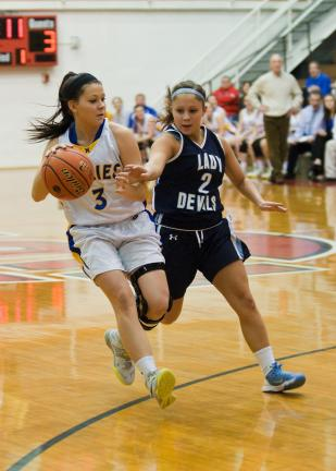 Steve Shinko/special to the TIMES NEWS Marian's Gabby Green tries to get past Jill Dove of Shenandoah Valley.