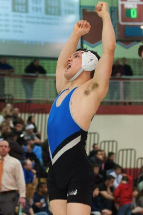 BOB FORD/TIMES NEWS Palmerton's Josh Evans celebrates after winning the Class AA 138-pound weight class at the Southeast Regionals this past weekend. This will be the second trip to the PIAA Championships for the Blue Bomber senior.