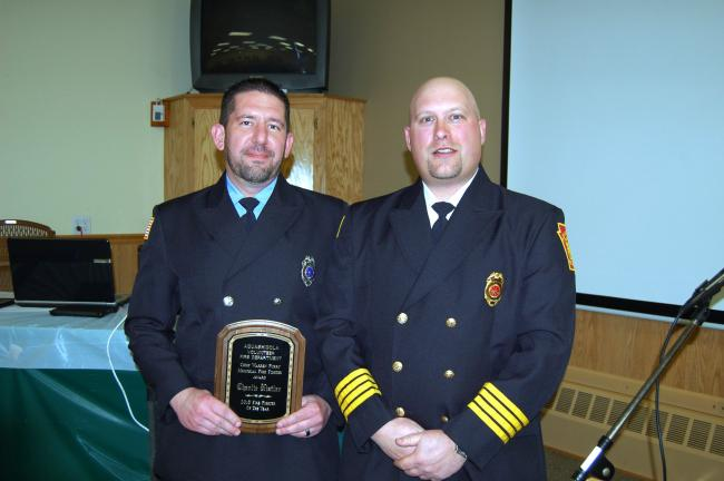LINDA KOEHLER/TIMES NEWS Aquashicola Fire Company named Charles Kistler, left, as its Chief Warren Furry Memorial Firefighter of the Year and Peter Beblavy, assistant fire chief/vice president presented him the award.