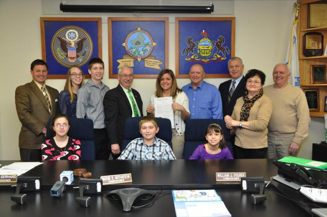 AMY MILLER/TIMES NEWS Members of the Carbon County 4-H program accept the proclamation from Carbon County commissioners naming the week of March 16 as 4-H week. Seated, from left, are, Samantha Leininger, Kyle Troxell and Alyssa Myers. Standing,…