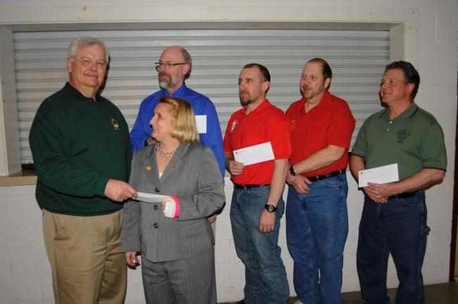 RON GOWER/TIMES NEWS Joel Christman, left, president of Franklin Township Lions Club, presents check to Nina Fehnel, representing Northeast Eye Bank. The Lions donated $10,500 to five organizations. Looking on are, l-r, Jim Blakeslee, representing…