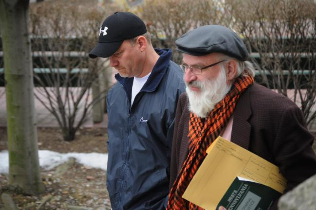 RON GOWER/TIMES NEWS Robert Eckhart, left, a volunteer coach at Palmerton Area High School, walks with his lawyer, Attorney George Dydynsky, as they enter the office of District Judge William J. Kissner for arraignment on charges he attempted to…