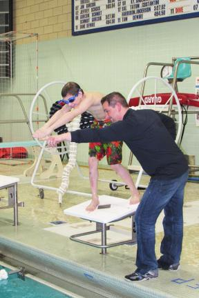 "LIZ PINKEY/SPECIAL TO THE TIMES NEWSCoach ""Wink"" Kovalchick instructs swimmer Anthony Witczak on the finer points of diving."