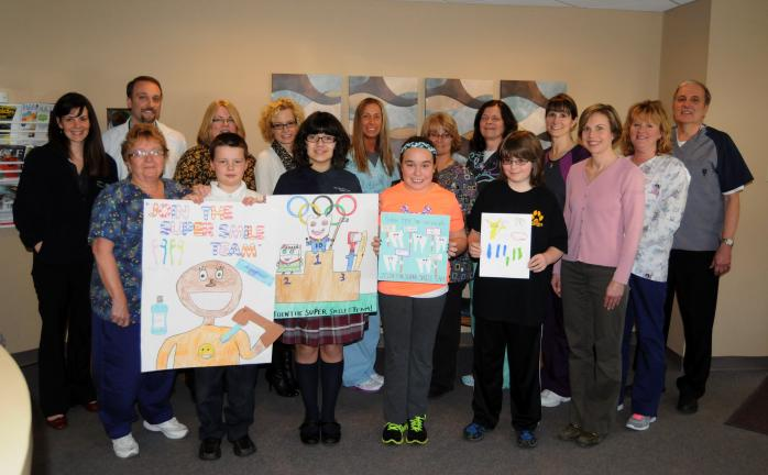 "RON GOWER/TIMES NEWS ""Join the Super Smile Team"" was the theme of a poster contest for elementary students, held by the Vermillion Dental Office of Summit Hill. At the dental office are employees and contest winners. They are, front from left, Mary…"